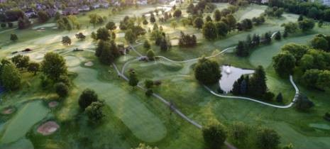 aerial of the golf course with morning mist
